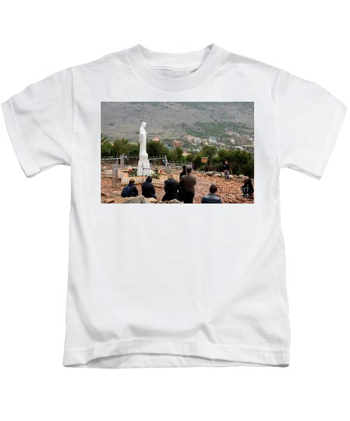 Catholic Pilgrim Worshipers Pray To Virgin Mary Medjugorje Bosnia Herzegovina Kids T-Shirt