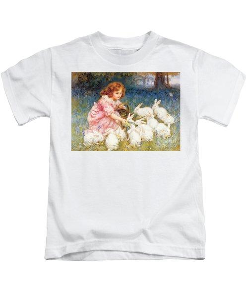 Feeding The Rabbits Kids T-Shirt by Frederick Morgan