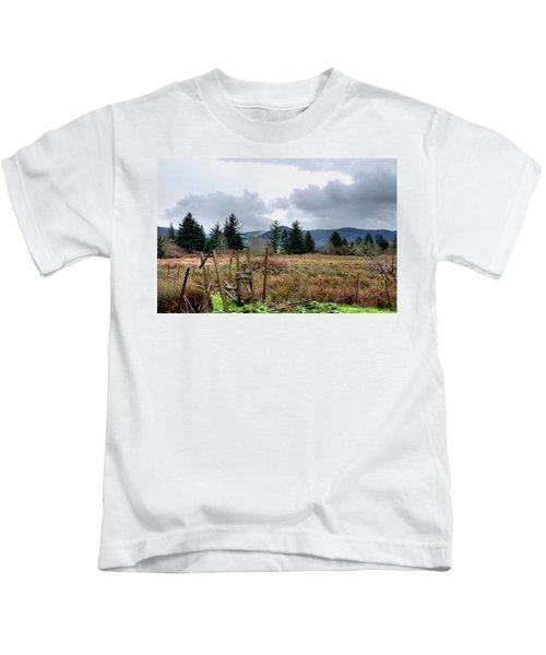 Field, Clouds, Distant Foggy Hills Kids T-Shirt