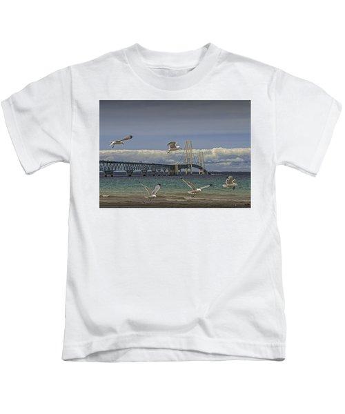 Gulls Flying By The Bridge At The Straits Of Mackinac Kids T-Shirt