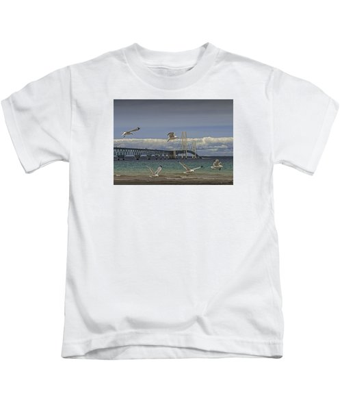 Gulls Flying By The Bridge At The Straits Of Mackinac Kids T-Shirt