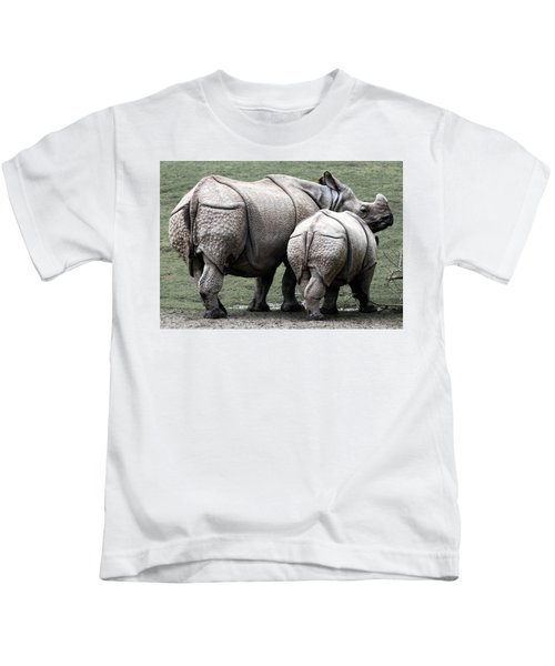 Rhinoceros Mother And Calf In Wild Kids T-Shirt by Daniel Hagerman