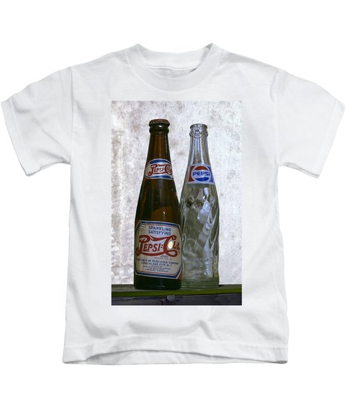 Two Pepsi Bottles On A Table Kids T-Shirt