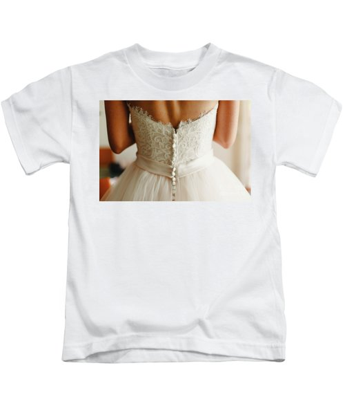 Bride Getting Ready, They Help Her By Buttoning The Buttons On The Back Of Her Dress. Kids T-Shirt