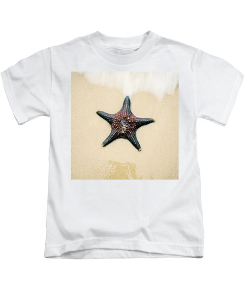 Starfish On The Beach Sand. Close Up. Kids T-Shirt