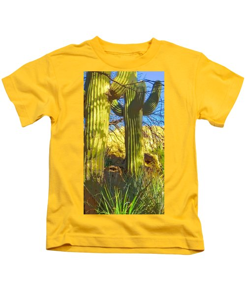 Kids T-Shirt featuring the photograph In The Shadow Of Saguaros by Judy Kennedy