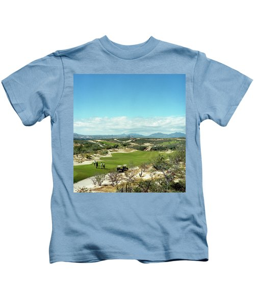 A Foursome Tees Off On A Golf Course Kids T-Shirt