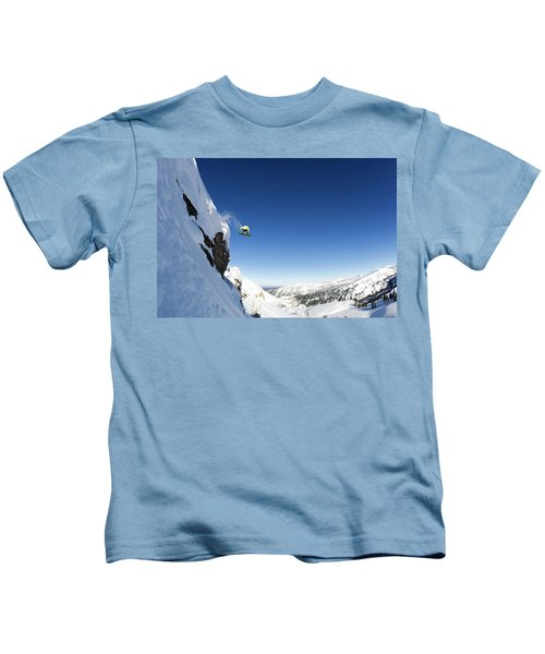 A Male Snowboarder Rides Off A 50 Foot Kids T-Shirt