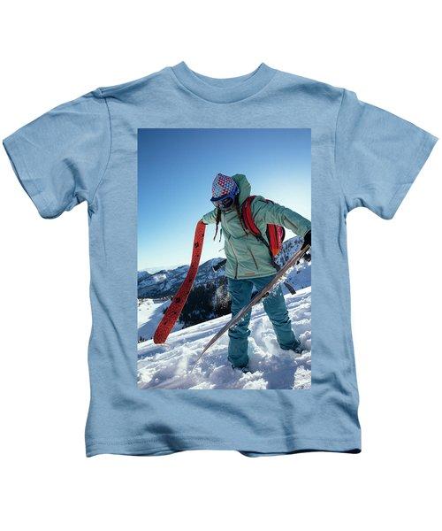 A Woman Backcountry Skiing Kids T-Shirt