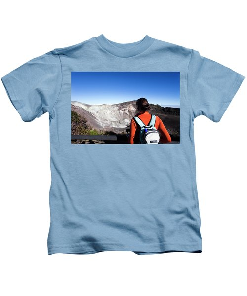 A Young Girl Looks At An Active Volcano Kids T-Shirt