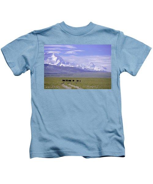 Group Of Yaks Walk Across A Green Kids T-Shirt