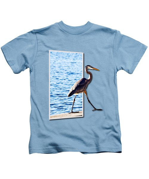 Blue Heron Strutting Out Of Frame Kids T-Shirt by Roger Wedegis