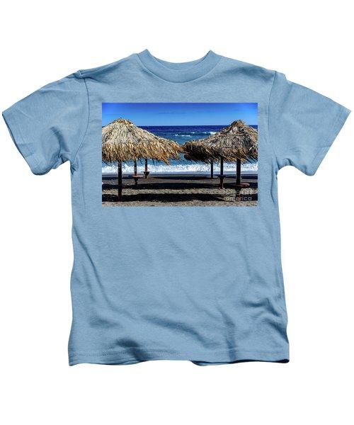 Wood Thatch Umbrellas On Black Sand Beach, Perissa Beach, In Santorini, Greece Kids T-Shirt