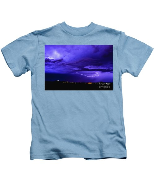 Rays In A Night Storm With Light And Clouds. Kids T-Shirt