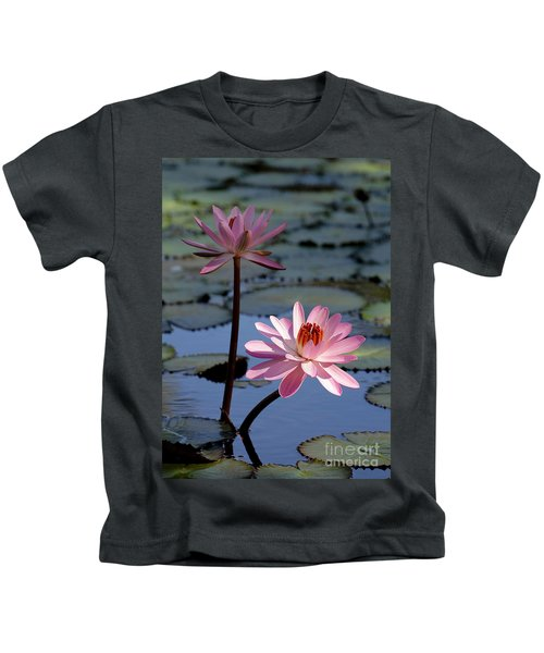 Pink Water Lily In The Spotlight Kids T-Shirt