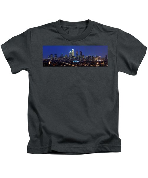 Buildings Lit Up At Night In A City Kids T-Shirt by Panoramic Images