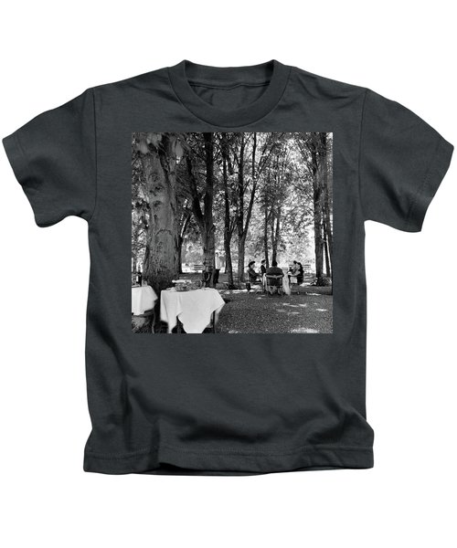 A Group Of People Eating Lunch Under Trees Kids T-Shirt