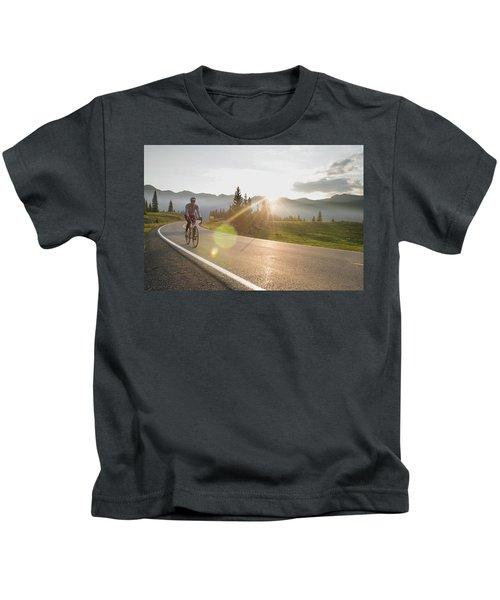 A Woman Road Biking On Highway 550 Kids T-Shirt