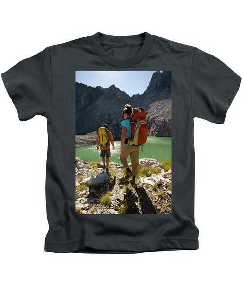 A Young Couple Hikes Above Timberline Kids T-Shirt