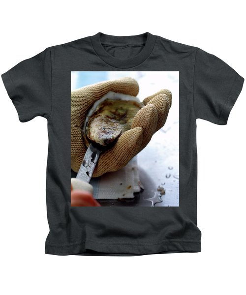 An Oytser Being Shucked Kids T-Shirt