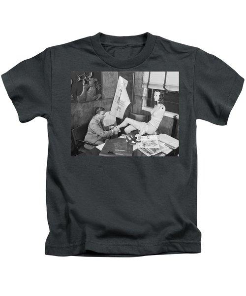 Man Adjusting A Mannequin Kids T-Shirt