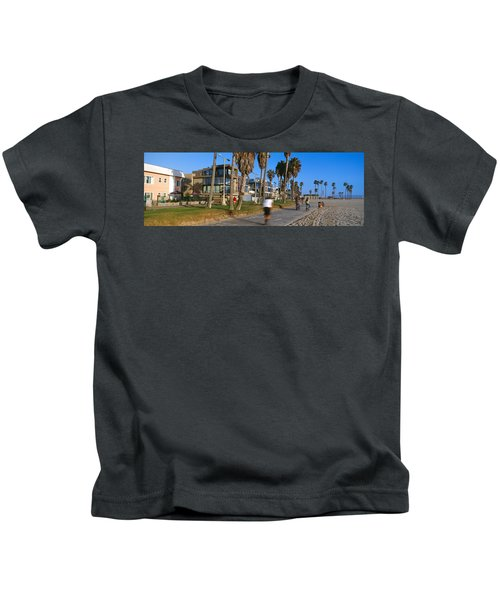 People Riding Bicycles Near A Beach Kids T-Shirt