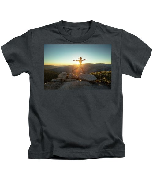 Person Leaping Along Rocks At Sunset Kids T-Shirt
