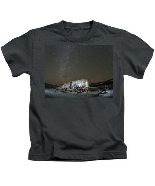 Wagon Train Under Night Sky Kids T-Shirt by Juli Scalzi