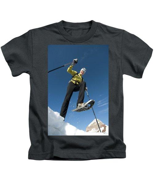 Woman Snowshoeing Below Mountain, San Kids T-Shirt