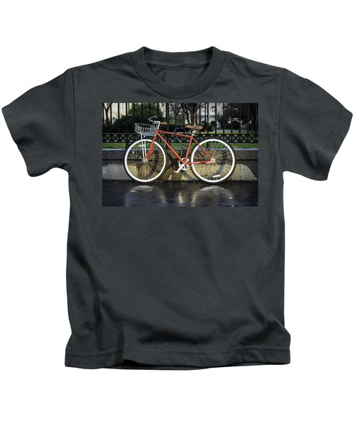 A Red Bicycle Near Jackson Square, New Orleans, Louisian Kids T-Shirt