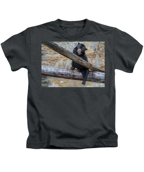 Black Bear Cub Sitting On Tree Trunk Kids T-Shirt