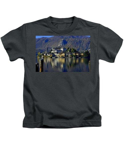 Buildings Reflected On Lake Orta H B Kids T-Shirt
