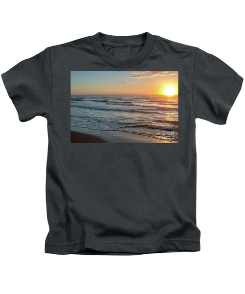 Calm Water Over Wet Sand During Sunrise Kids T-Shirt