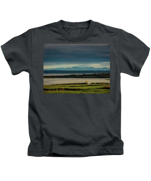 Kids T-Shirt featuring the photograph Dark Skies Over Ireland's Shannon Estuary by James Truett