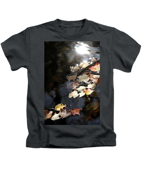 Dry Leaves Floating On The Surface Of A Stream Kids T-Shirt