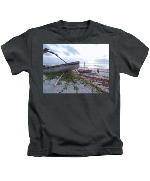 early morning African fisherman and wooden dhows Kids T-Shirt