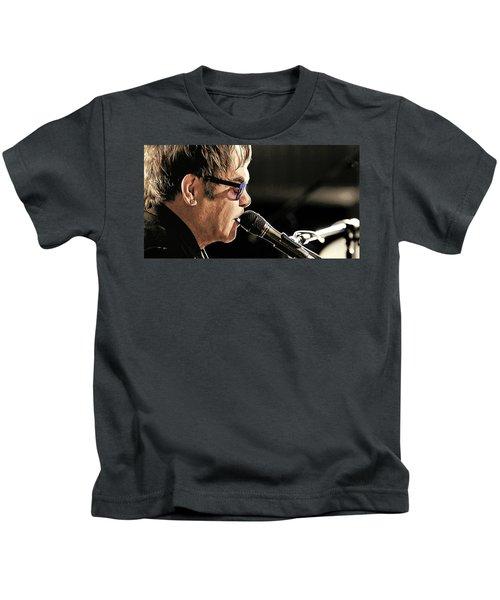 Elton John At The Mic Kids T-Shirt by Elaine Plesser