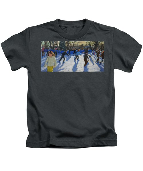 Ice Skaters At Christmas Fayre In Hyde Park  London Kids T-Shirt by Andrew Macara