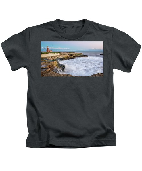 Long Exposure Of Waves Against The Cliff With Lighthouse In Shot Kids T-Shirt