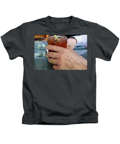 Mans Hand Holding Bloody Mary  Kids T-Shirt by Beth Wolff
