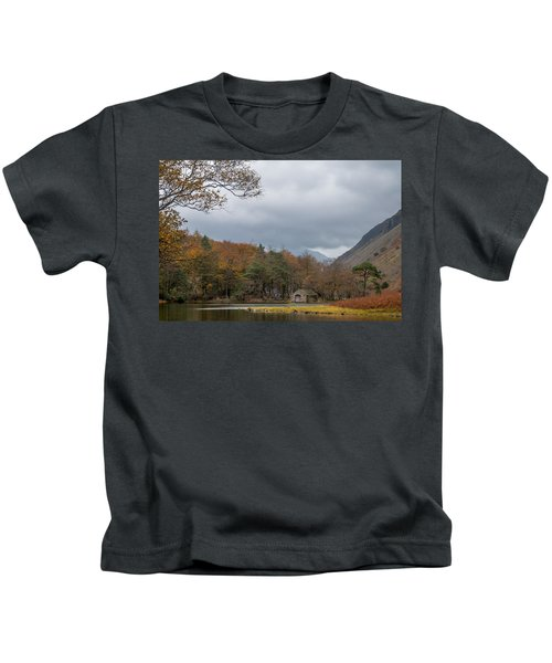 Moody Clouds Over A Boathouse On Wast Water In The Lake District Kids T-Shirt