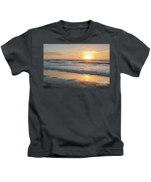 Rising Sun Reflecting On Wet Sand With Calm Ocean Waves In The B Kids T-Shirt