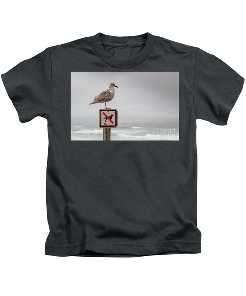 Seagull Standing On Sign And Looking At The Ocean Kids T-Shirt