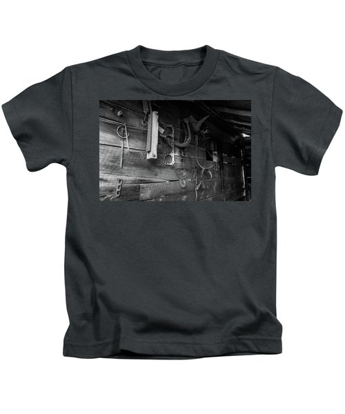 Kids T-Shirt featuring the photograph Spare Parts by Doug Camara