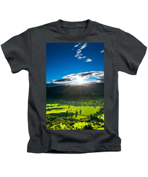 Sunrays Flood Farmland During Sunset Kids T-Shirt