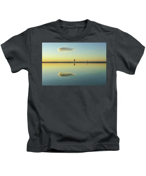 Woman And Cloud Reflected On Beach Lagoon At Sunset Kids T-Shirt
