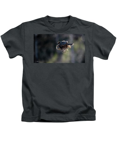 Ural Owl Flying Against The Light To Catch A Prey  Kids T-Shirt
