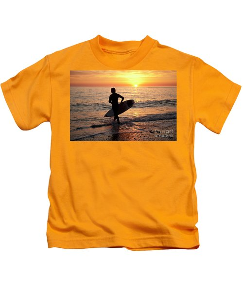 A Young Man Surfing At Sunset Off Aberystwyth Beach, Wales Uk Kids T-Shirt