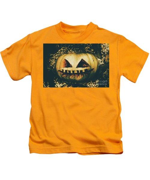 Closeup Of Halloween Pumpkin With Scary Face Kids T-Shirt