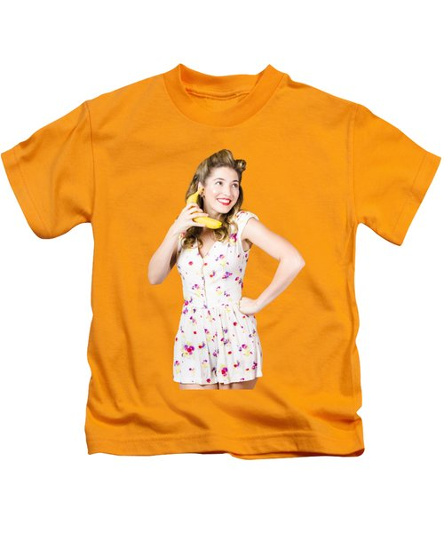 Retro Pin Up Girl Chatting On Banana Telephone Kids T-Shirt by Jorgo Photography - Wall Art Gallery